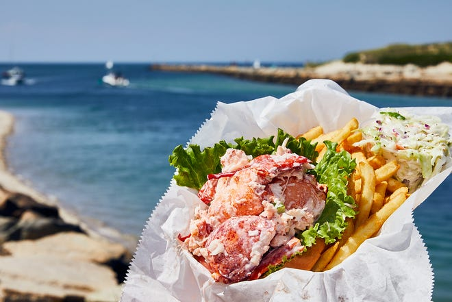 The Sesuit Harbor Cafe's popular lobster roll is paired with a lovely view.