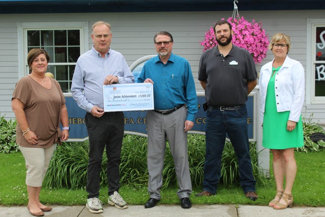 Representatives from the Cheboygan Area Chamber of Commerce and Visitors Bureau, including Polly Schneider, Tom McKinley and Rick Wolfgram, presented Junior Achievement Tip of the Mitt Director Matt Berger and Junior Achievement Tip of the Mitt Board Chair Nancy Lindsay with a donation from the chamber of $1,000.
