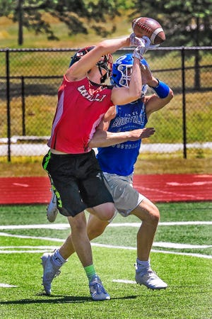Then-senior-to-be Chillicothe High School football Hornet Isaak Rasche makes a fine, fingertip grab of a pass in front of a Boonville Pirates defender during the 2019 Chillicothe 7-on-7 prep football tournament at Chillicothe's Jerry Litton Memorial Stadium II. After a COVID-19-caused cancellation last year, the tournament is set to return to the stadium this Saturday.
