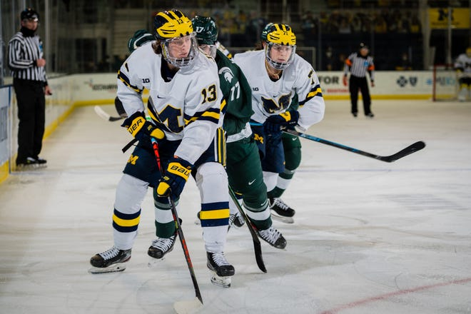 Kent Johnson, selected by the Blue Jackets with the No. 5 overall pick in the 2021 NHL draft, handles the puck in a game against Michigan State on Jan. 8, 2021.