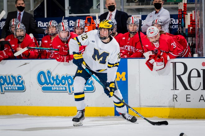 Owen Power looks to pass the puck in a game against Ohio State on Jan. 15.