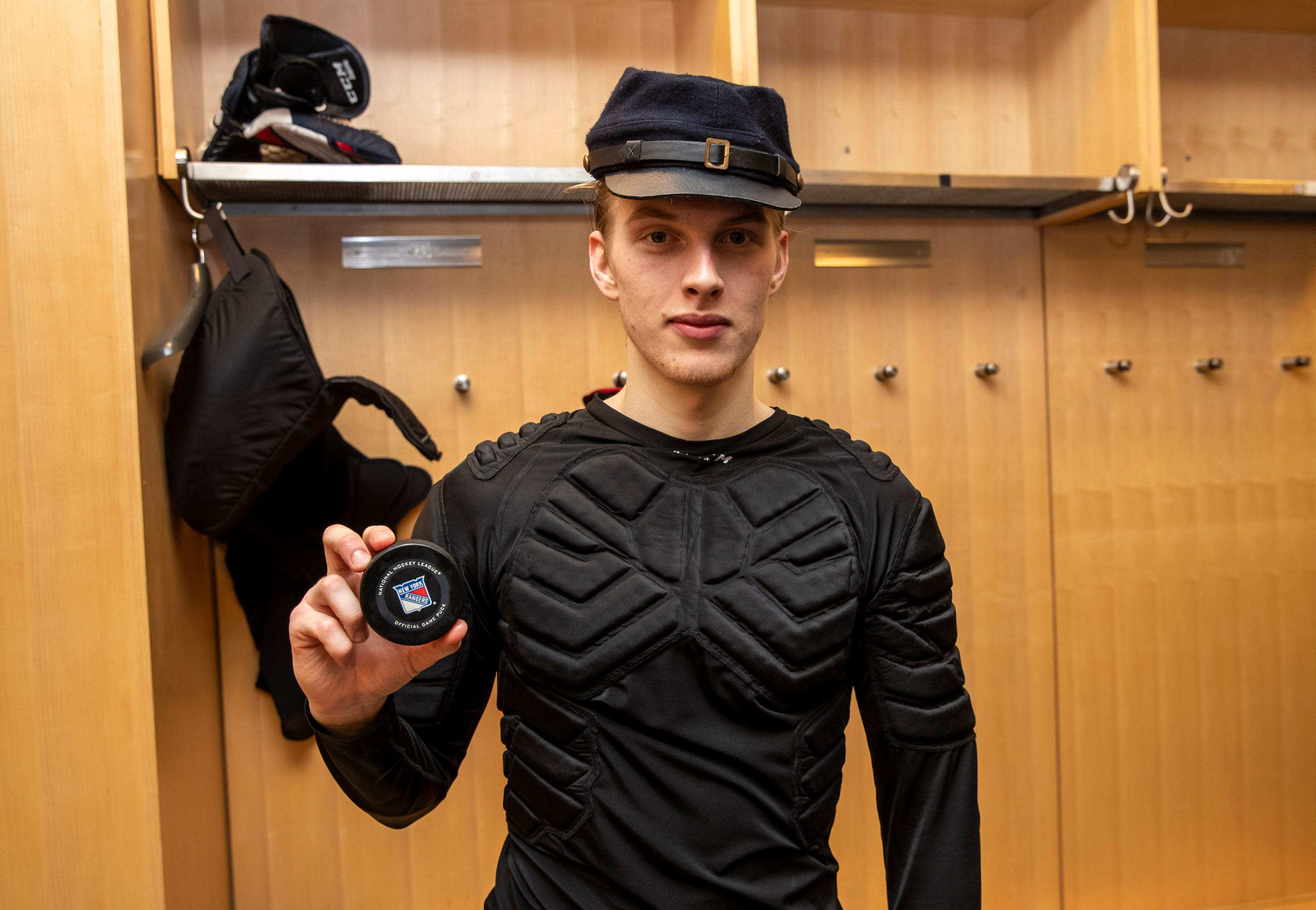 Former Blue Jackets goalie Matiss Kivlenieks poses with the game puck after earning his first NHL victory against the New York Rangers on Jan. 19, 2020 at Madison Square Garden.