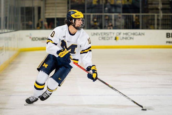 Matty Beniers carries the puck in a game against Michigan State on Jan. 8, 2021.