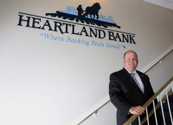 """Scott McComb, CEO of Heartland Bank, says Destin, Florida, is a """"business-friendly growth market."""" Heartland is opening an office there."""