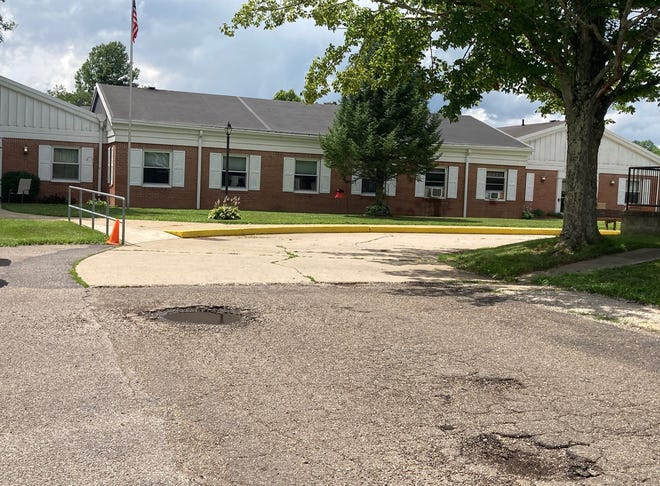 Guernsey County commissioners approved a $51,000 paving project to resurface the entrances, visitors' and staff parking lots at Countryview Assisted Living on County Home Road. The entrances, as seen here, have numerous potholes that will be repaired during the project.
