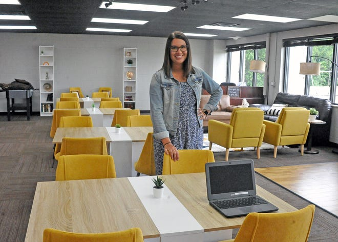 Courtney Starkey, the high school director at Wooster Christian School, stands in the high school classroom. The space was previously used by the youth group at Church of the Saviour, but now will double as a classroom during the school year.