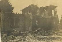 Charred remains of the Riga branch of the Jipson-Carter bank and Post Office, following the fire that swept through downtown Riga during the early morning hours of July 11, 1908, are pictured. This concrete bank building was one of the few buildings not totally destroyed by the fire.