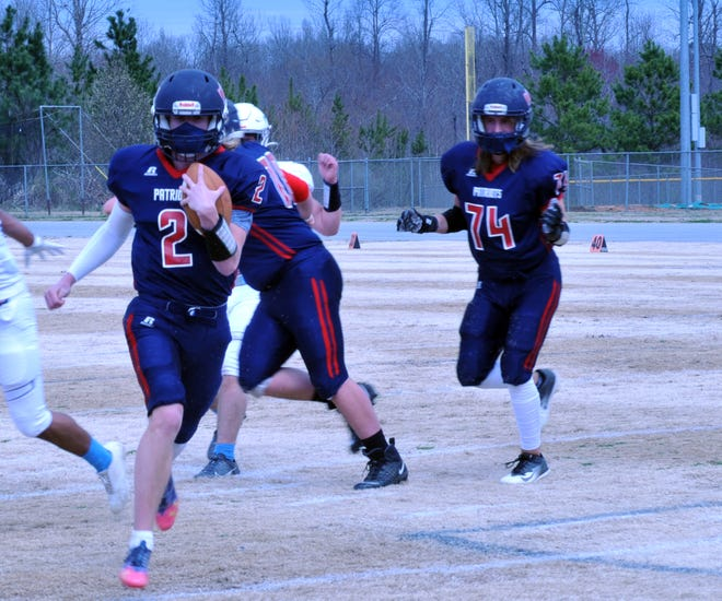 Providence Grove quarterback Luke Thomas (2) runs for a touchdown against Trinity. Thomas is a  college prospect. [Mike Duprez/Courier-Tribune]