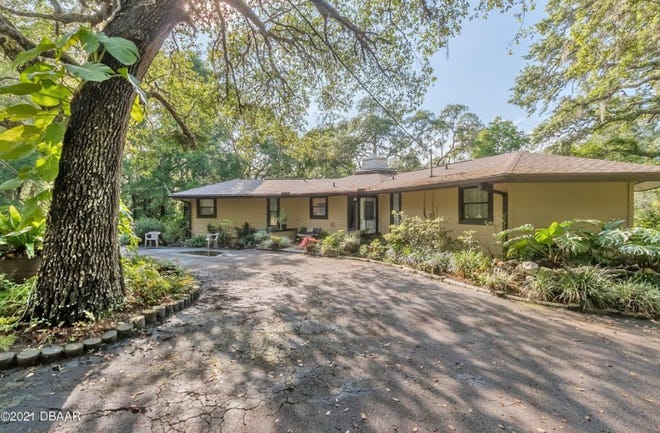 Sitting on nearly three park-like acres on a spring-fed, waterski lake, this Pierson property features a two-bedroom, two-bath main house, a two-bedroom, one-bath guesthouse and a detached oversized, concrete-block garage/workshop, with a full bath.
