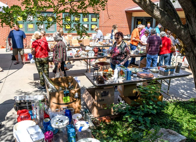 Area residents browse through items for sale on the Finney County Historical Museum's patio Saturday during the annual Flea Market Festival.  The event returned to having vendors this year after a 2020 pandemic year with none.