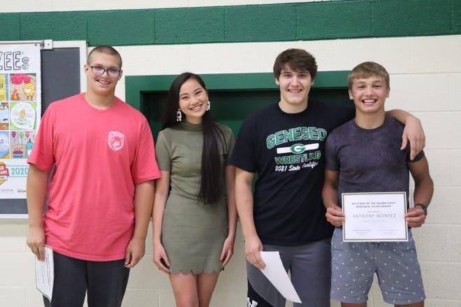 Olivia Egert presented the Shawn Egert Memorial Team Camp Scholarships to Levi Neumann, left; Tim Stohl and Anthony Montez.
