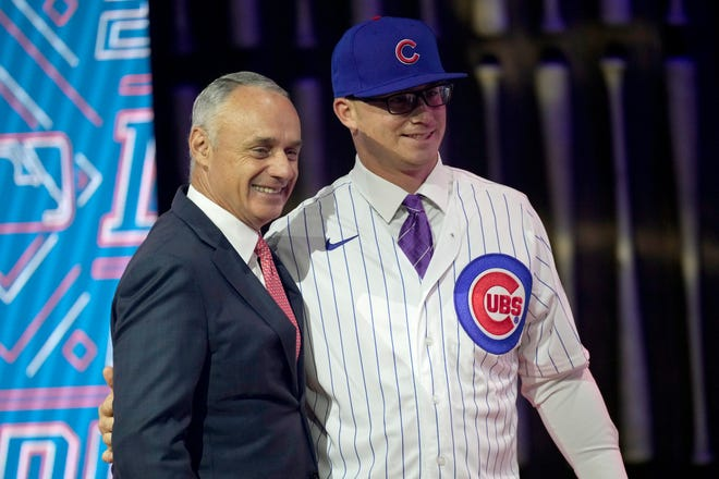 Kansas State's Jordan Wicks stands with MLB Commissioner Rob Manfred after being selected by Chicago Cubs as the 21st pick in the first round of the 2021 MLB baseball draft on Sunday, July 11, 2021, in Denver.