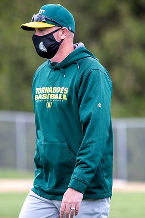 Abingdon-Avon High School baseball coach Kent Jones observes the action in a game against Knoxville on Monday, May 10, 2021 at Billy Notz Memorial Field.