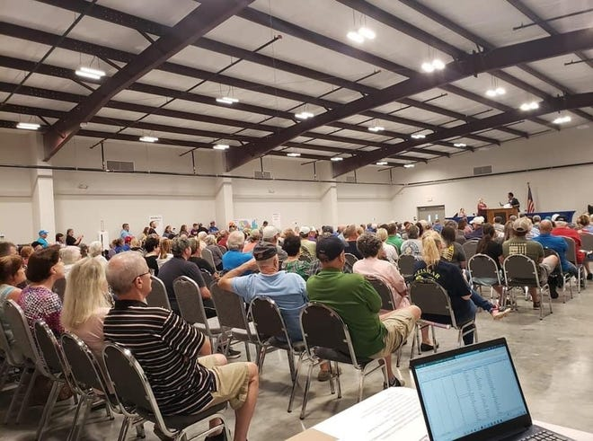 The crowd listens to speakers during the July 11 meeting held at the VFW Hall on Churchpoint Road.