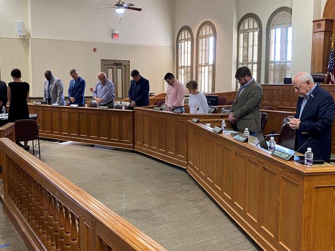 """Ascension Parish Council members stand at the beginning of the meeting held July 1 at the courthouse in Donaldsonville. Pictured from left are Alvin """"Coach"""" Thomas, Joel Robert, Corey Orgeron, Dempsey Lambert, Chase Melancon, Teri Casso, Aaron Lawler, and John Cagnolatti."""