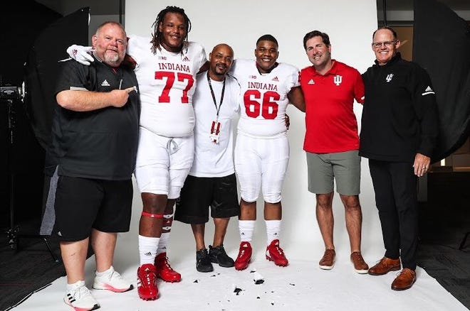 Demon Moore (No. 77) stands next to offensive line coach Darren Hiller (left) during his official visit to IU on June 18.