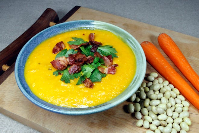 Carrot and Mayocoba Soup is filling and colorful.  Topping it with parsley and pancetta or bacon adds complexity to the pureed soup.