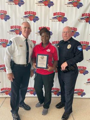Joreeca Dinnall, center, was named School Resource Officer of the Year.