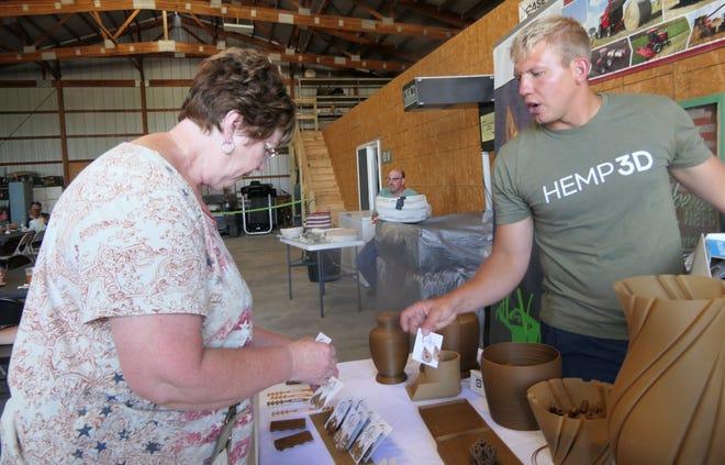Reva Dougherty buys hemp earrings from Andrew Bader during a Hemp open house in Great Bend, Kansas.
