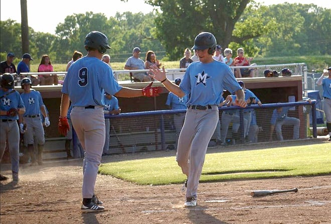 Hutchinson's Dylan Nedved (9) congratulates teammate Colton Cowser after both Monarchs scored runs against Great Bend in this file photo from 2019 at Hobart-Detter Field.