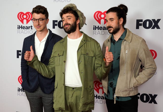 Ryan Met, from left, Jack Met, Adam Brett Met, of AJR, attend the iHeartRadio Music Awards at the Dolby Theatre on Thursday, May 27, 2021, in Los Angeles. (AP Photo/Chris Pizzello)