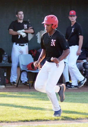Newton Rebel Justin Barnes comes home to score during play Sunday against the 316 Sluggers.