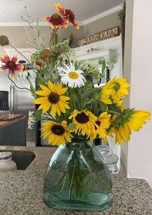 In addition to fresh vegetables, vendors at the Downtown Farmers Market feature fresh flowers and other locally made products