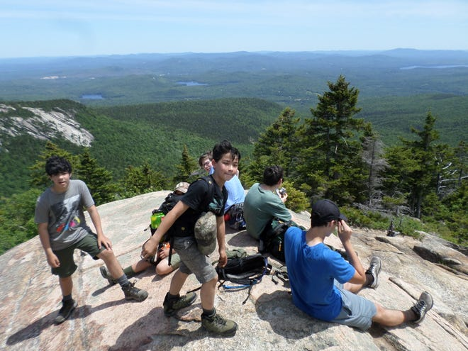 Taking a break on the Piper Trail near the top of Mount Chocorua.