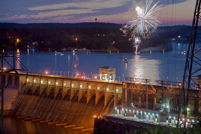 Bagnell Dam with fireworks in the background.