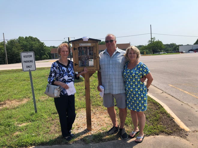 A mini library of church books was installed by the Ozark Chapel United Methodist Church in Laurie. Pictured is the family that donated the books following the passing of Larry Potts, owner of the collection.