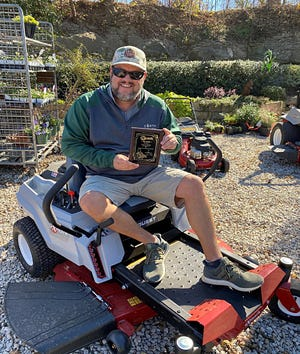 Kevin Klein of Earthtones Greenery in Midlothian recently received an award from Exmark Lawnmowers for outstanding sales.