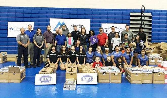Representatives from Midlothian ISD and other city dignitaries pose with volunteers during the 2019 Back to School Bash. This year's Back to School Bash will take place Saturday, Aug. 14 from 9 a.m. to 3 p.m. at MISD Multipurpose Stadium.