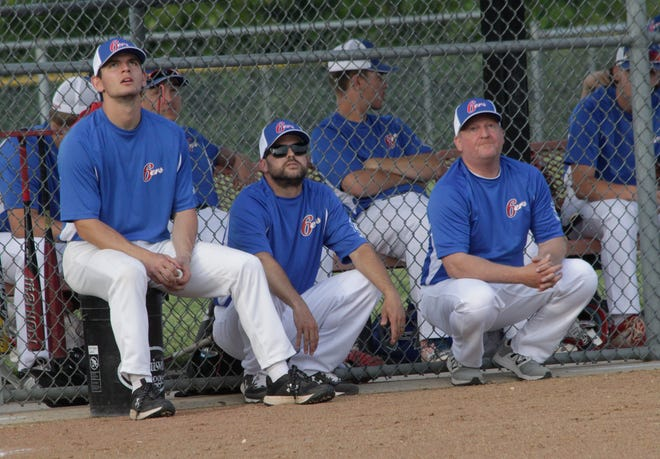 A fly ball catches the attention of NEMO Post 6 Sixers coaches Jackson Truesdell, Drew Hunt and Kevin Pipes as they sit outside of the team's dugout during a home baseball game played earlier this 2021 season.