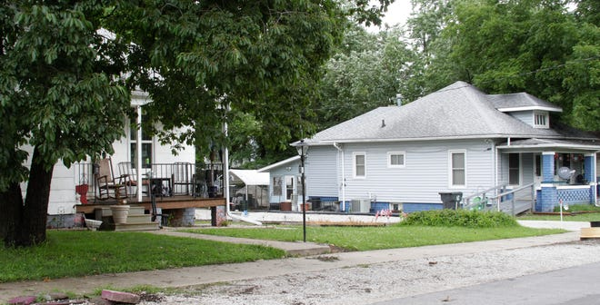 This street scene between the residences at  313 E. Burkhart, left, and 319 E. Burkhart, right, on the night of July 8 is where Mitchell Duane Nickerson was found by Moberly police officers lying in the street with a gun shot wound to his head. Jerry Fitzwater was arrested at his home at 319 E. Burkhart and is accused of shooting the victim, who died over the weekend.