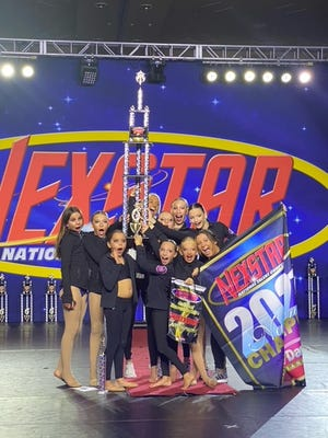 Bedford High School graduates Kelsey Varwig (top) and Ana Jakubowski (bottom right) pose with one of their two national title-winning teams at the recent Nexstar National Talent Competition. The two former Mules are co-directors of the competitive dance program at Perrysburg, Ohio-based studio, The Dance Factory.
