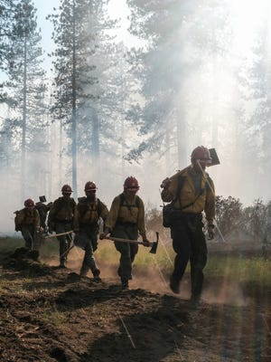 Firefighters work on the Bradley Fire in the McCloud area on Monday morning, July 12, 2021.