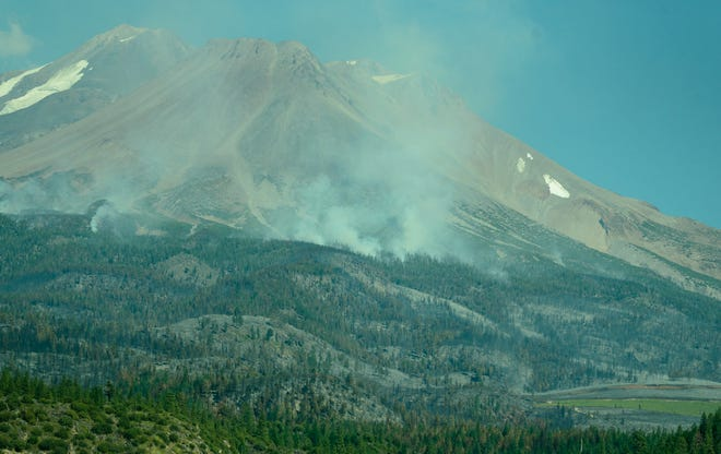 Smoke can be seen rising from Mt. Shasta's flanks from Lake Shastina over the weekend of July 10 and 11, 2021.