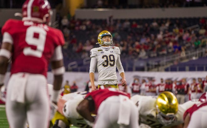 Notre Dame's Jonathan Doerer (39) lines up an extra point kick against Alabama in the College Football Playoff Rose Bowl game  Jan. 1, 2021 in Arlington, Texas. Doerer's field goal make percentage slipped last season.