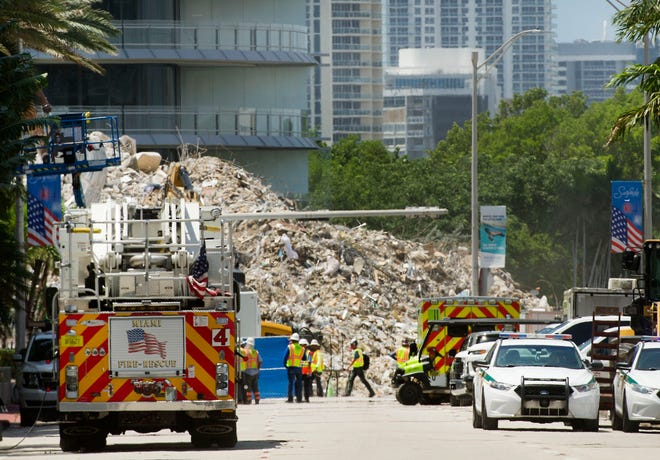 Workers search the site of the collapsed Champlain Towers South building Sunday in Surfside. MEGHAN McCARTHY/Palm Beach Post