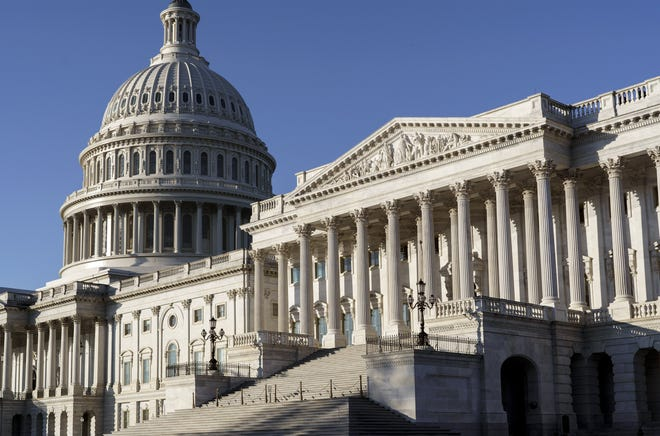 FILE - In this Nov. 9, 2020 file photo, the Senate side of the Capitol is seen in Washington. Looming over the Senate Democrats this year is a decision that could fundamentally change Congress as it has operated for decades. That's whether they should change or eliminate the rules of the filibuster. (AP Photo/J. Scott Applewhite)