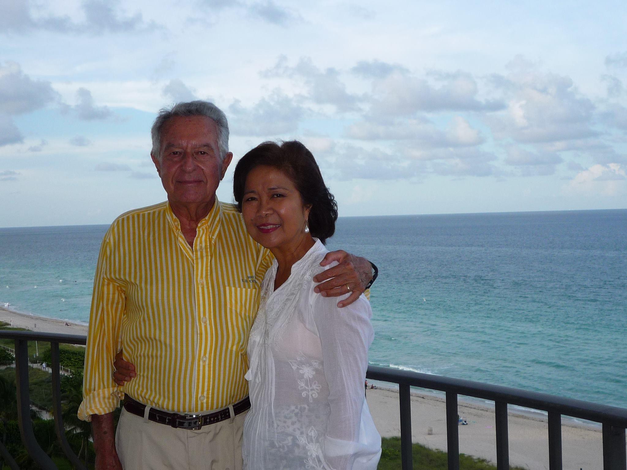 Claudio Bonnefoy and Maricoy Obias Bonnefoy on the balcony of their oceanfront condo.