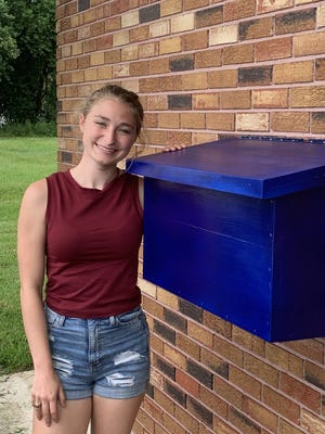 Alyssa Daigle built a flag retirement box for her Girl Scout gold award project.