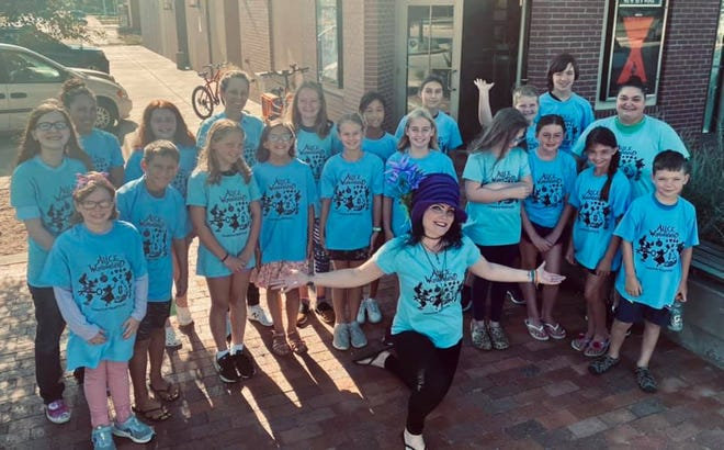A Twilight Players cast of young people from Kiowa County put on a performance of Alice in Wonderland last weekend at the Twilight Theater in Greensburg, led by director Alyssa Brown (front).