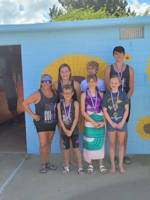Swimmers of the Year from Pratt in 2021 include (back from left) Coach Tonja Harrison, Magdalen Haas, Kyler Barker, Arley Morrel, and (front) Archer Deeds, Maisy Fields and Johanna Forssberg.