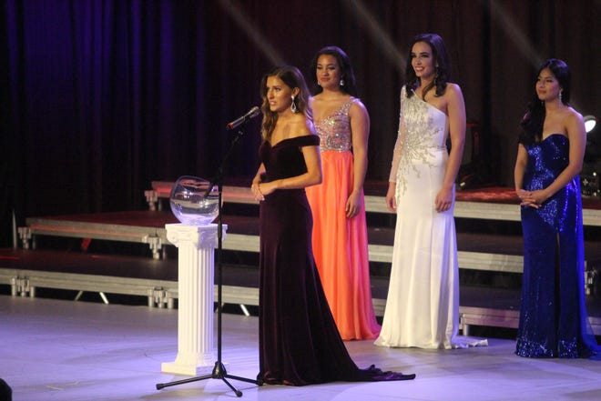 Miss Boot Hill Ayanna Hensley, from Dodge City, anwers an interview question during the finals of the 2021 Miss Kansas Competition on Saturday, in which she finished as the first runner-up. Taylor Clark, Miss Augusta (white dress), was crowned the new Miss Kansas.