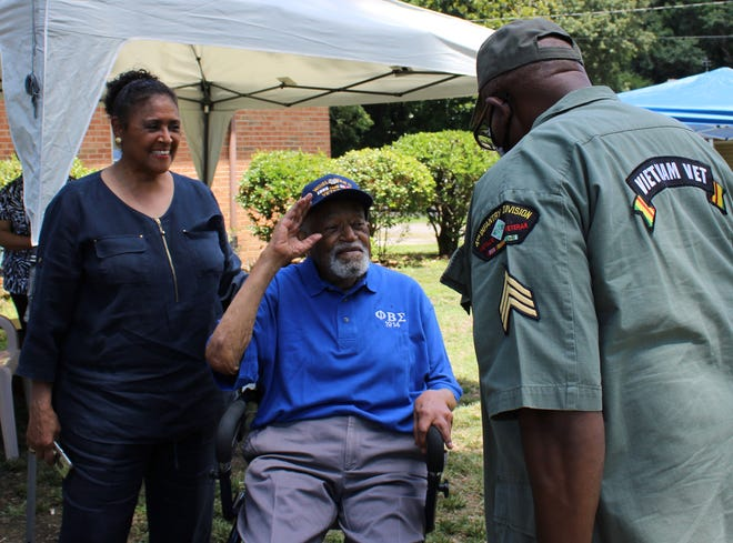 Retired Lt. Col. Louis Frazier Martin and Sgt. Albert W. Cooks [Vietnam Veteran 69/70, UMES Alumnus, Class of 1967] salute during Martin's 104 birthday celebration in Chesterfield, Va. on July, 3, 2021. Also pictured is Martin's daughter Sheila Martin Brown.