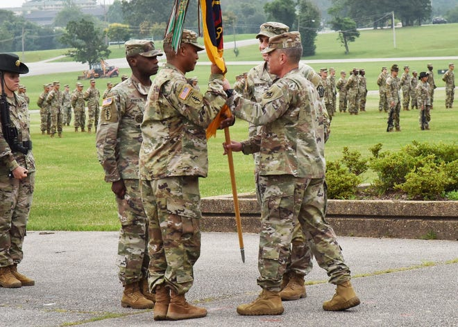 During a change-of-command ceremony July 8 on Gammon Field, Col. Fredrick Parker (center left) accepts the 3rd Chemical Brigade colors from Col. Sean Crockett, U.S. Army Chemical, Biological, Radiological and Nuclear School commandant, as Col. Adam Hilburgh, outgoing commander, and Command Sgt. Maj. Joe Johnson look on. Photo by Spc. Jayde Shooks, U.S. Army Chemical, Biological, Radiological and Nuclear School