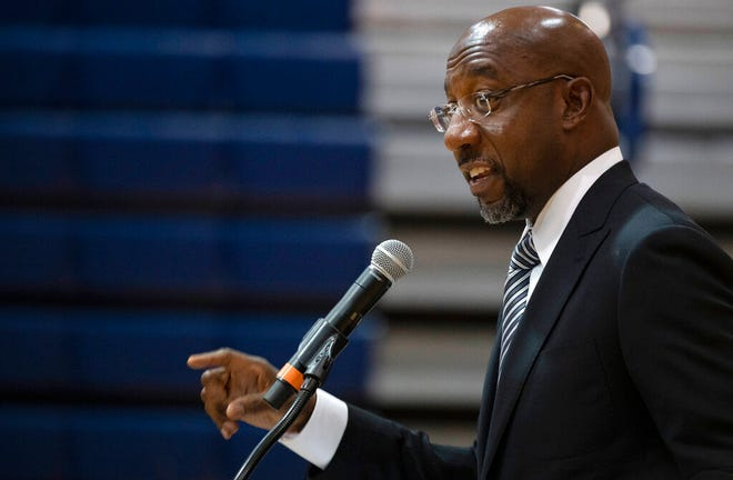 Sen. Raphael Warnock, D-Ga., speaks at Alfred E. Beach High School in Savannah, Ga., Thursday, July 8, 2021. Warnock joined fellow Democratic senators Jon Ossoff of Georgia and Tammy Baldwin of Wisconsin in introducing a bill on Monday, July 12, 2021, to require the federal government to set up a Medicaid-like health plan in states that have not expanded Medicaid plans to cover more low-income adults. Jim Watson/Pool via AP