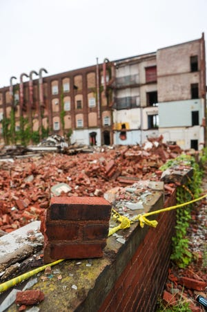 Demolition has begun on the old factory turned flea market at 645 S. Chestnut Street in Ravenna.