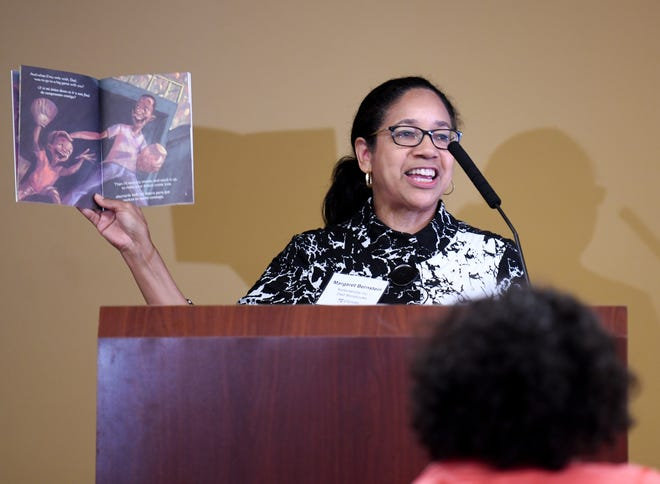 Author Margaret Bernstein of Dad Storybooks reads from one of her books after receiving a $10,000 Back2Business grant from Fiserv and Huntington Bank during a gathering Monday at Gold Jacket Lounge at Pro Football Hall of Fame.